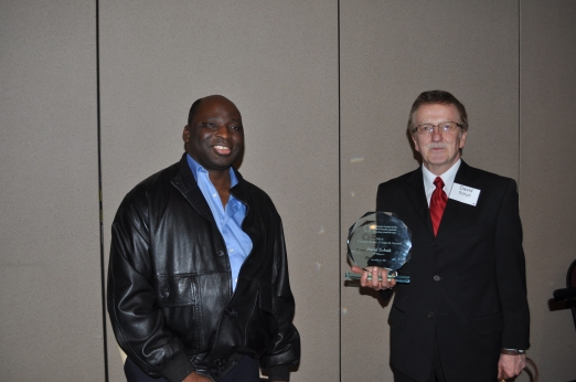 Council Board member Deen Amusa presented Dave Schuh with the 2014 Friend of the Council award.